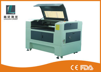 China High Accuracy Desktop CO2 Laser Engraver , LCD Control Fabric Laser Engraving Machine supplier